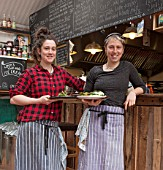 WHICHFORD POTTERY, WARWICKSHIRE: THE CAFE - MAIA KEELING AND CHRISTINE BOTTINE IN THE CAFE WITH FRESHLY PREPARED FOOD