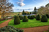 BROUGHTON GRANGE, OXFORDSHIRE: VIEW FROM THE LOWER PARTERRE OF THE WALLED GARDEN TO LAWN WITH CLIPPED TOPIARY YEWS - COUNTRYSIDE BEYOND - BORROWED L;ANDSCAPE, COUNTRY, GARDEN