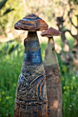 LA JEG, PROVENCE, FRANCE: DESIGNER ANTHONY PAUL - MEADOW WITH TERMITE HILL SCULPTURE. ORNAMENT, SPRING, MAY, ART, ARTISTIC