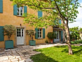 LA JEG, PROVENCE, FRANCE: DESIGNER ANTHONY PAUL - COURTYARD, HOUSE, LAWN, PAVING, STONE, PATH, VERSAILLES CONTAINER, SPRING, MEDITERRANEAN