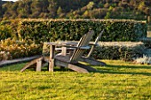 LA JEG, PROVENCE, FRANCE: DESIGNER ANTHONY PAUL - TWO WOODEN ADIRONDACK CHAIRS. SEAT, SEATING, BENCH, LOUNGER, LOUNGERS, MEDITERRANEAN, GARDEN, GREEN, PROVENCE, MAY