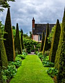 WOLLERTON OLD HALL, SHROPSHIRE: GRASS PATH TO ARCH IN WALL, PYRAMID TOPIARY CLIPPED YEW. FORMAL, ARTS AND CRAFTS, GREEN, LAWN, MAY, SUMMER
