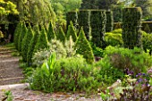 BRYANS GROUND, HEREFORDSHIRE: THE SUNK GARDEN - ARTS AND CRAFTS - CLIPPED BOX TOPIARY AND IRISH YEWS, ELEAGNUS ANGUSTIFOLIA QUICKSILVER. FORMAL, COUNTRY GARDEN
