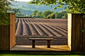 BRYANS GROUND, HEREFORDSHIRE: BRIDIES LIGHTBOX - NAMED AFTER A FELL TERRIER BORN IN 2008 - WOOD STRUCTURE WITH BENCH ON DECK - VIEW TO OPEN FARMLAND - BORROWED LANDSCAPE