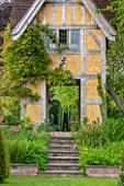 BRYANS GROUND, HEREFORDSHIRE: VIEW OF STEPS AND DOVECOTE DESIGNED BY SIMON DORRELL - BUILDING, COUNTRY GARDEN, ARTS AND CRAFTS, MAY, SPRING, FOLLY, SUMMER HOUSE, SUMMERHOUSE