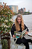 HOPE SHARP STORY, CHELSEA FLOWER SHOW 2016: HOPE SHARP ON HER HOUSE BOAT ON CADOGAN PIER ON THE THAMES