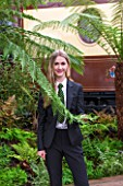 HOPE SHARP STORY, CHELSEA FLOWER SHOW 2016: HOPE SHARP BESIDE A FERN IN THE BOWDENS STAND - BEHIND IS ZENA - SISTER TRAIN TO THE ORIENT EXPRESS
