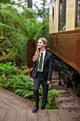 HOPE SHARP STORY, CHELSEA FLOWER SHOW 2016: HOPE SHARP BESIDE A FERN IN THE BOWDENS STAND - BESIDE IS ZENA - SISTER TRAIN TO THE ORIENT EXPRESS