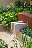 CHELSEA FLOWER SHOW 2016: WATER FEATURE- SPOT, RILL, FOUNTAIN - VESTRA WEALTH GARDEN OF MINDFUL LIVING DESIGNED BY PAUL MARTIN - SHADE, SHADY, LIMESTONE, CORTEN STEEL