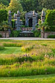 ARUNDEL CASTLE GARDENS, WEST SUSSEX: LAWN WITH MEADOW OF GRASSES AND ALLIUM CHRISTOPHII - BULB, BULBS, SUMMER, COLLECTOR EARLS GARDEN, JULIAN AND ISABEL BANNERMAN
