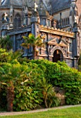 ARUNDEL CASTLE GARDENS, WEST SUSSEX: COLLECTOR EARLS GARDEN DESIGNED BY JULIAN AND ISABEL BANNERMAN. TRACHYCARPUS FORTUNEI, PATH, PATHS, SUMMER, GREEN, OBERONS PALACE