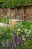 PRIVATE GARDEN LONDON DESIGNED BY LUCY WILLCOX AND ANA SANCHEZ MARTIN: FORMAL TOWN GARDEN WITH BRICK WALL, STONE SEAT / BENCH, PLEACHED HORNBEAM, ALLIUM MOUNT EVEREST