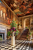 CHATSWORTH HOUSE, DERBYSHIRE: FLORABUNDANCE-THE PAINTED HALL DECORATED 1687-1694 BY LOUIS LAGUERRE BEAUTIFUL FLORAL DISPLAY ON STONE PLINTH. INTERIOR, OPULENCE, GRAND, STAIRCASE
