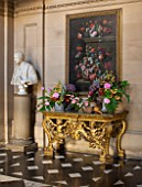 CHATSWORTH HOUSE, DERBYSHIRE: FLORABUNDANCE - THE PAINTED HALL; GILDED TABLE WITH FLORAL ARRANGEMENTS AND STILL LIFE IN FLOWERS PAINTING BY JEAN-BAPTISTE MONNOYER