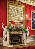 CHATSWORTH HOUSE, DERBYSHIRE: FLORABUNDANCE-THE GREAT DINING ROOM; FIREPLACE DRESSED WITH BORDER OF FOXGLOVES,ALLIUMS,HONESTY AND PEONIES. INTERIOR,GRAND,SUMPTUOUS,OPULENT.