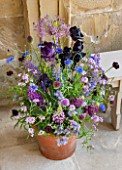 CHATSWORTH HOUSE, DERBYSHIRE: FLORABUNDANCE-FLORAS TEMPLE;LILAC POT WITH LUPINS,ALLIUM CRISTOPHII,ALLIUM SPHERACEPHALON,DEEP PURPLE BEARDED IRIS AND CANDYTUFT.DISPLAY,ARRANGEMENT