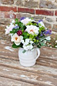 THE REAL FLOWER COMPANY: FLORAL ARRANGEMENT. WHITE PORCELAIN JUG WITH ROSA MARGARET MERRILL AND WILDFLOWER MIX OF ALCHEMILLA,ASTRANTIA,SENECCIO AND MINT.FRAGRANT,SUMMER,VINTAGE
