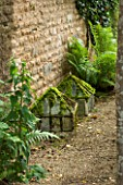 THE LODGE, BURFORD, OXFORDSHIRE: OLD VICTORIAN CLOCHES WITH FERNS BY HOUSE WALL. DETAIL.ANTIQUE, GARDEN.