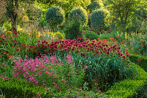 EASTLEACH_HOUSE_GLOUCESTERSHIRE_RED_BORDER__MONARDA_SQUAW_PENSTEMON_CROCOSMIA_LUCIFER_FLOWERS_FLOWER