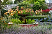 BELMONT HOUSE, SUSSEX - DESIGN ANTHONY PAUL: WALLED GARDEN, WATER FEATURE, FOUNTAIN, AGAPANTHUS, LILIES, COSMOS, MONARDA