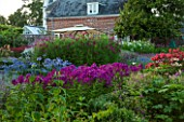 BELMONT HOUSE, SUSSEX - DESIGN ANTHONY PAUL: WALLED GARDEN, MONARDA, PHLOX, AGAPANTHUS, COSMOS, SUMMER, JULY