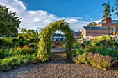 MORTON HALL GARDENS, WORCESTERSHIRE: KITCHEN GARDEN IN LATE SUMMER. GREENHOUSE, COUNTRY, HOUSE, CLASSIC, VEGETABLE, ARCH, ARCHWAY, SKY, CLEMATIS