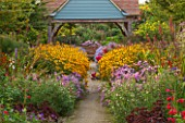 ASTON POTTERY, OXFORDSHIRE: SUMMERHOUSE, GARDEN BUILDING, PAVILION. LATE SUMMER, SEDUM MATRONA, PENSTEMON KING GEORGE, ASTER X FRIKARTII MONCH, LOBELIA TUPA, RUDBECKIA DEAMII