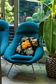 ABIGAIL AHERN HOUSE, LONDON: THE LIVING ROOM - BLUE CHAIR WITH CUSHION - SITTING ROOM