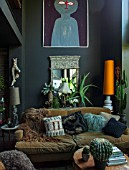 ABIGAIL AHERN HOUSE, LONDON: THE LIVING ROOM WITH SOFA, SETTEE, CUSHIONS, BURNT ORANGE LAMPSHADE, MIRROR, DARK, INTERIOR, SITTING ROOM, FAKE CACTUS