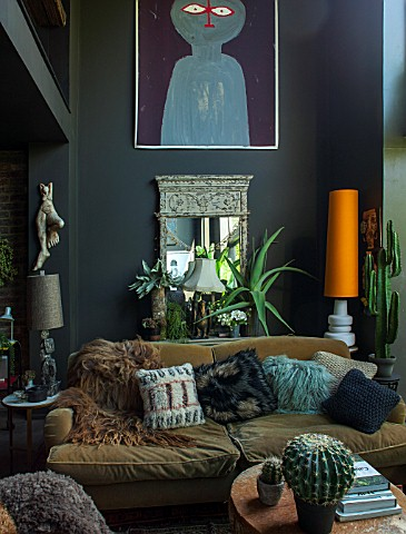 ABIGAIL_AHERN_HOUSE_LONDON_THE_LIVING_ROOM_WITH_SOFA_SETTEE_CUSHIONS_BURNT_ORANGE_LAMPSHADE_MIRROR_D