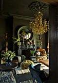 ABIGAIL AHERN HOUSE, LONDON: THE OFFICE / STUDIO. FIREPLACE, CONVEX MIRROR, ROOM PAINTED IN HUDSON BLACK PAINT, LAZZARO CHANDELIER