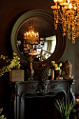 ABIGAIL AHERN HOUSE, LONDON: THE OFFICE / STUDIO. FIREPLACE, CONVEX MIRROR, ROOM PAINTED IN HUDSON BLACK PAINT, LAZZARO CHANDELIER - LIGHTS, LIGHTING