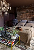 ABIGAIL AHERN HOUSE, LONDON: BEDROOM PAINTED IN CROSBY - MAUD THE DOG ON BED, PILLOWS, HAGUE WOODEN BEADED CHANDELIER, DARK, ROOM, INTERIOR, STAGHORN PLANT, THROW