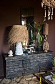 ABIGAIL AHERN HOUSE, LONDON: BEDROOM PAINTED IN CROSBY - DARK, ROOM, INTERIOR, DAWLISH SIDEBOARD WITH STONE FACADE. SHAGGY PALM LAMP, MIRROR