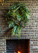 ABIGAIL AHERN HOUSE, LONDON: THE DINING ROOM - DARK, INTERIOR, WALL, DECORATION, GREEN WREATH, WALL, FIREPLACE