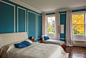 MORTON HALL, WORCESTERSHIRE: MASTER BEDROOM WITH EAST FACING WINDOWS. WALLS ARE FARROW & BALL CHINESE BLUE WITH MOULDINGS IN FB ALL WHITE. WOODEN FLOOR