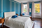 MORTON HALL, WORCESTERSHIRE: MASTER BEDROOM WITH EAST FACING WINDOWS. WALLS ARE FARROW & BALL CHINESE BLUE WITH MOULDINGS IN FB ALL WHITE. WOODEN FLOOR AND BEDSIDE TABLES