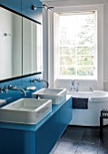 MORTON HALL, WORCESTERSHIRE:MASTER BATHROOM WITH WOODEN FITTED CUPBOARDS PAINTED WITH FB CHINESE BLUE,BATH & SINK BY DURAVIT,BATHTUB DESIGNED BY PHILIPPE STARK.TAPS BY DORNBRACHT