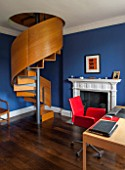 MORTON HALL, WORCESTERSHIRE: BEDROOM PAINTED FB DRAWING ROOM BLUE.19TH CENTURY FIREPLACE.SPIRAL STAIRCASE IN BRUSHED STEEL & SMOKED OAK BY CARL GEORG LUETCKE