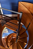 MORTON HALL, WORCESTERSHIRE: DETAIL OF SPIRAL STAIRCASE IN BRUSHED STEEL AND SMOKED OAK, DESIGNED BY CARL GEORG LUETCKE. LOOKING DOWN FROM BEDROOM INTO STUDY