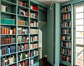 MORTON HALL, WORCESTERSHIRE: SECRET DOOR IN LIBRARY SHELVES LEADING TO GYM