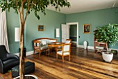 MORTON HALL, WORCESTERSHIRE: GARDEN ROOM PAINTED IN FB DIX BLUE. OVAL TABLE CA. 1820, CHERRY WOOD, SOUTHERN GERMAN.ARMCHAIRS IN WALNUT, CA. 1825 SOUTH WEST GERMAN. WOODEN FLOOR.