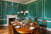 MORTON HALL,WORCS:DINING ROOM WITH KEIM OPTIL MINERAL PAINT.ORIGINAL DRAWING ROOM OF C18TH HOUSE.ORIGINAL MOULDINGS,ANTIQUE EXTENDABLE ELM WOOD TABLE AND CHERRY WOOD CHAIRS