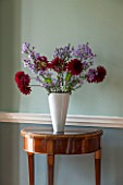 MORTON HALL, WORCESTERSHIRE: MAIN HALLWAY. FLORAL ARRANGEMENT ON MAHOGANY EMPIRE SEMI-CIRCULAR CONSOLE TABLE WITH MARBLE TOP CA.1800 FRENCH. FARROW & BALL PAINT