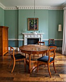 MORTON HALL, WORCESTERSHIRE:BREAKFAST ROOM (FORMER LIBRARY). PAINTED FB GREEN BLUE & OVAL ROOM BLUE. CIRCULAR WALNUT TABLE & CHERRY WOOD DINING CHAIRS CA.1825