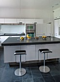 MORTON HALL, WORCESTERSHIRE: KITCHEN BY ARCLINEA DESIGNED BY CITTERIO. SOLID ACRYLIC SURFACES, WORKTOPS IN BRAZILIAN SLATE. APPLIANCES BY GAGGENAU