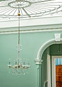MORTON HALL, WORCESTERSHIRE:MINT GREEN PAINTED STAIRWELL WITH ART NOUVEAU SKYLIGHT & CHANDELIER IN BOHEMIAN CRYSTAL. AREA CONNECTS TWO PARTS OF HOUSE-CENTRAL & VICTORIAN WING