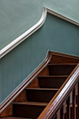 MORTON HALL, WORCESTERSHIRE: DETAIL OF WOODEN STAIRCASE IN HALLWAY PAINTED FB GREEN-BLUE (ABOVE DADO) AND OVAL ROOM BLUE (BELOW DADO)