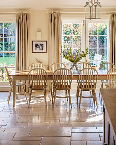 THE_COACH_HOUSESURREYBREAKFAST_ROOM_WITH_LARGE_TABLE__CHAIRS_MANDARIN_STONE_FLOOR_FLOOR_TO_CEILING_S
