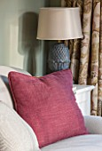 THE COACH HOUSE,SURREY: THE GARDEN ROOM WITH DETAIL OF SOFA, CLARET CUSHION AND LAMP BY OKA
